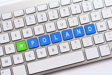 POLAND writing on white keyboard with a aircraft sketch
