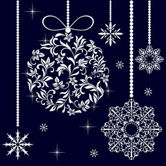 Christmas ball from a floral ornament and snowflakes on the dark blue background