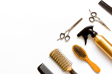 combs and hairdresser tools on white background top view