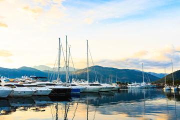 Luxury yacht marina. Port in Mediterranean sea at sunset.