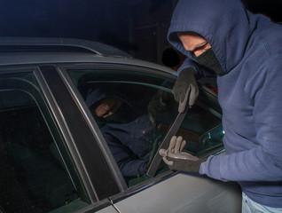 Car thief looking to break into a car