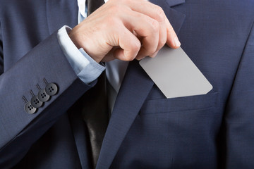 Businessman in suit holding blank card with YOUR TEXT OR IMAGE