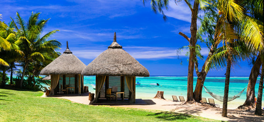 Fototapete - Relaxing tropical holidays with bungalows and hammock on white beach