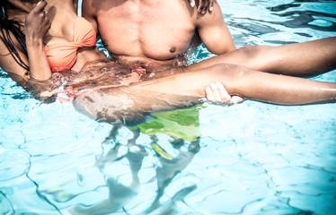 Couple walking in the swimming pool
