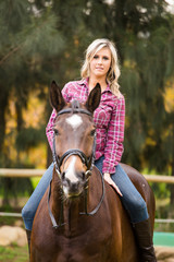 Beautiful elegance back woman cowgirl, riding a horse wearing bl