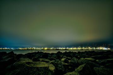 Rocks At Sea Shore Against Sky At Night