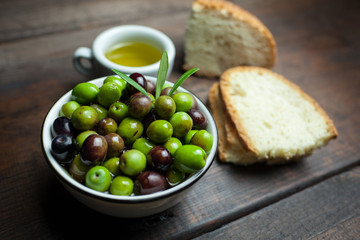 Close-Up Of Olives And Bread On Table