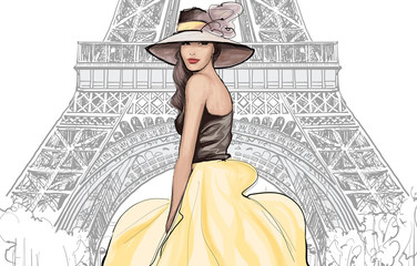 Wall Murals Art Studio Young pretty fashion model with hat in Paris