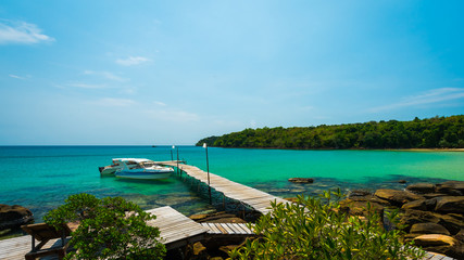 Wall Mural - Beautiful green view with blue sea and old wooden bridge at Koh Kood island, Wooden port for speed boat located Trat Province , Thailand