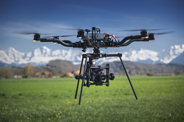 Big professional camera drone in mid-air.