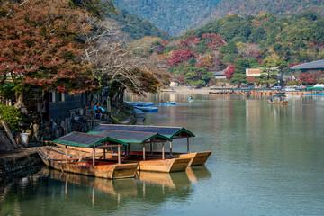 Arashiyama and tourist boat in autumn season