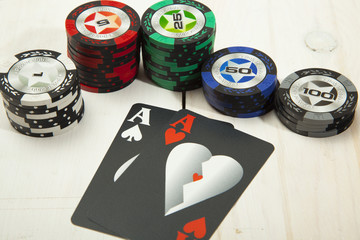 Combination of cards, the game  poker on a white wooden table