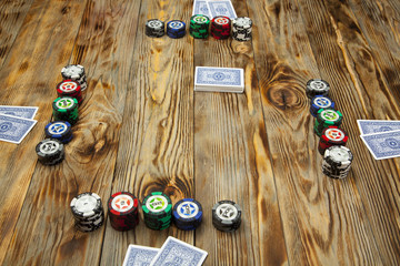 Playing poker on the old wooden table
