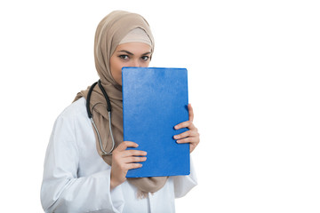 portrait of worried muslim female Medical doctor holding paperclip isolated