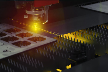 The laser cutter machine while cutting the sheet metal