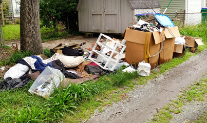 Trash and litter in residential neighborhood alley. Horizontal.