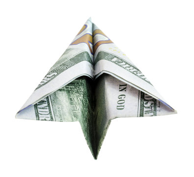 Above view of paper currency airplane. Horizontal.