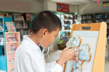asian boy doing homework .