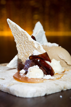 Finest Italian Coffee espresso jelly strips, served on a sweet Meringue bed, with chocolate and toffee crumble, salted toffee sauce and ice cream.