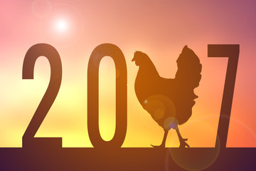Silhouette of chicken with '2017' word at the sky sunset, Happy new year concept