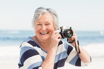 Senior woman taking picture
