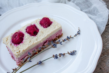 Raw cashew cake (cheesecake) and berries (strawberries, cherries), lavender on a wooden background. . Perfect for the detox diet or just a healthy dessert.  Love for a healthy raw food concept.