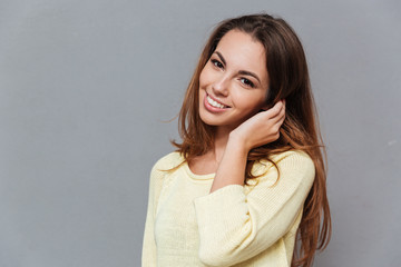 Smiling lovely woman in sweater looking at camera