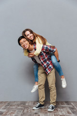 Full length portrait of a young cheerful couple having fun