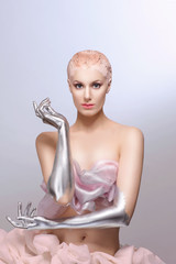 Beauty cyber woman from the future with clay hairstyle, silver hands and skirt