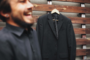 Wedding suit and laughing groom