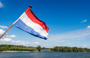 Dutch national flag on the stern of a boat