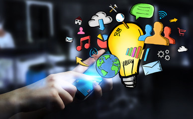 Businessman holding hand drawn lightbulb and multimedia icons