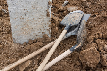 Shovels putted into heap of ground