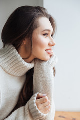 Side view of model in sweater