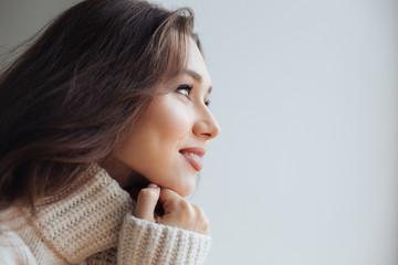 Side view of pretty model in sweater