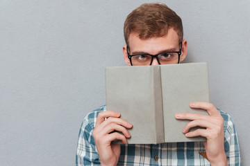 Student in glasses with book