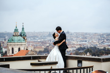 Bride and groom on roof