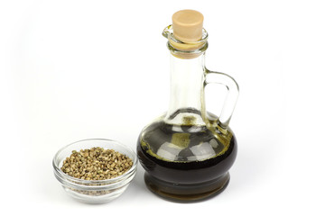 Hemp seed oil is poured into the bottle