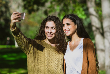 Two young pretty girls taking selfie