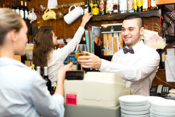 Employees working in a bar