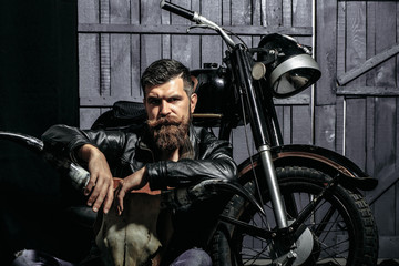 Bearded man hipster biker