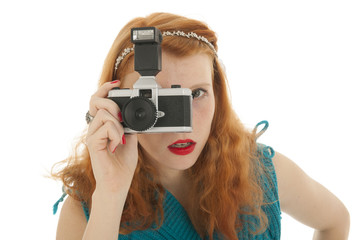 Portrait girl with photo camera and red hair