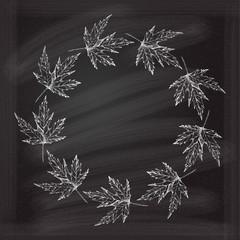 Maple leaves frame on a chalkboard background
