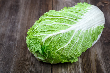 Fresh cabbage on a wooden background