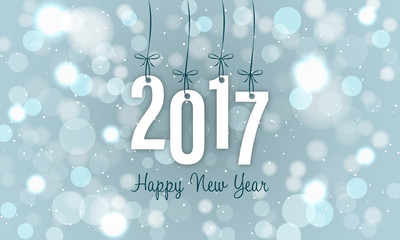 New Year banner with blurred circles and glitters in the background. Year 2017.