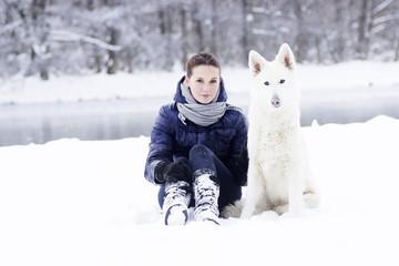 Girl and dog, winter walk