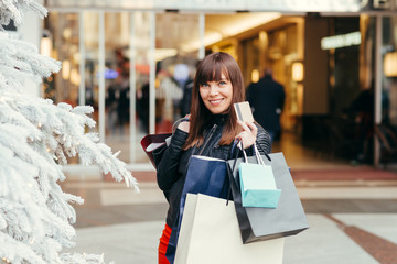 Christmas Shopping. Beautiful Happy Girl With Credit Card