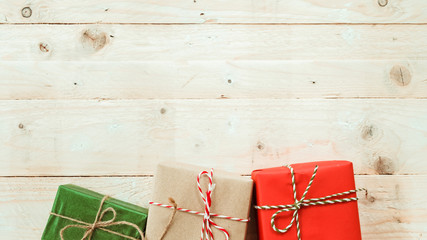 Vintage Christmas theme banner background with handmade  rustic gift boxes. top view on white wooden board with copy space. vintage filter effect