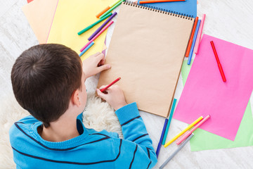 Cute boy draw, writing letter to santa, wait for christmas