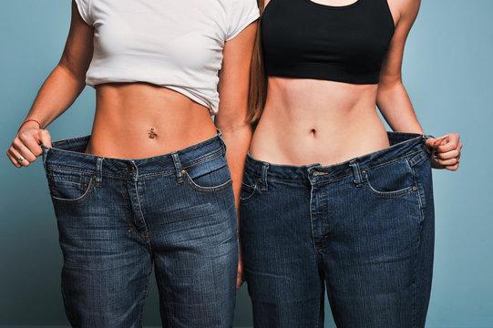 Women shows her weight loss.